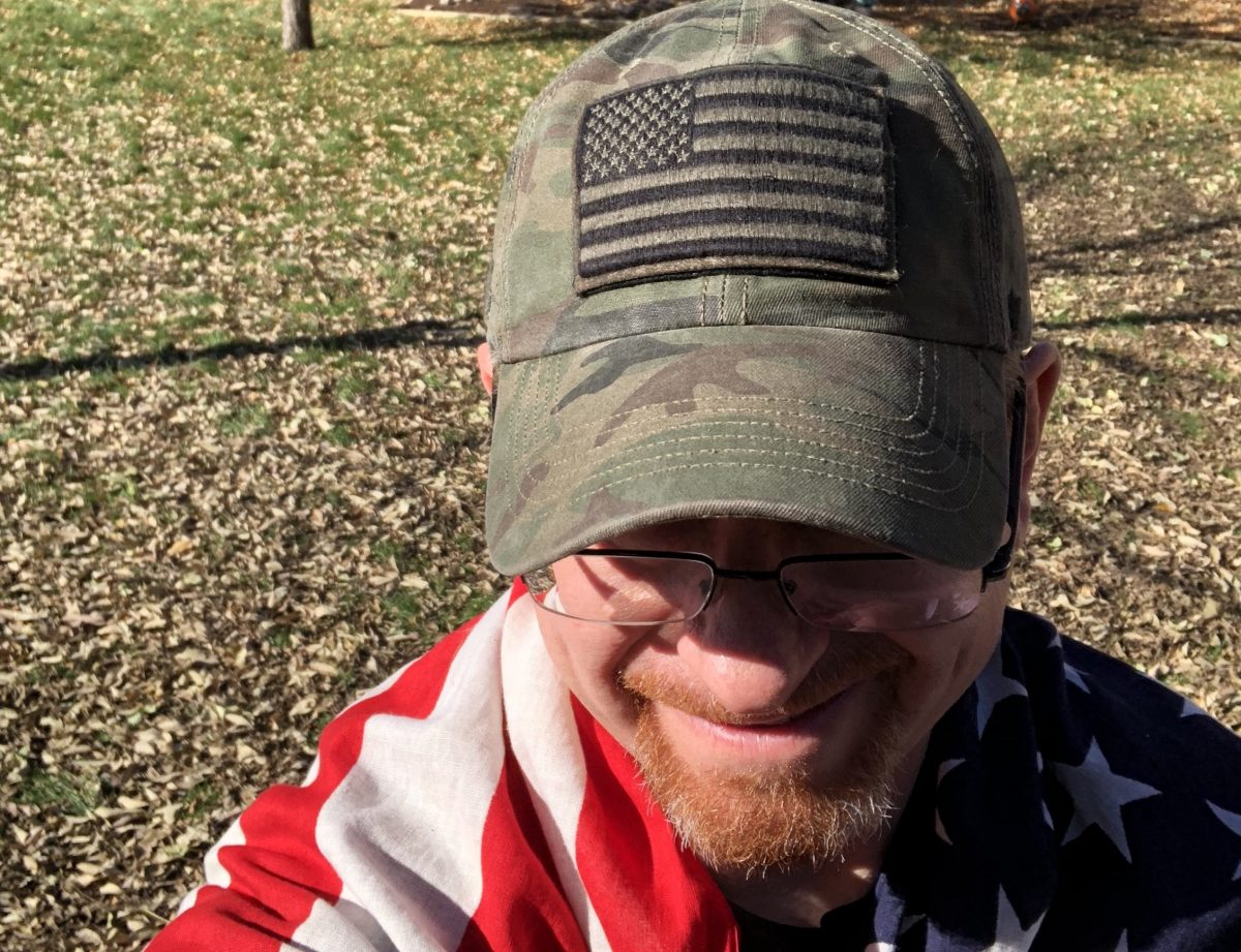Image of the author wrapped in an American Flag