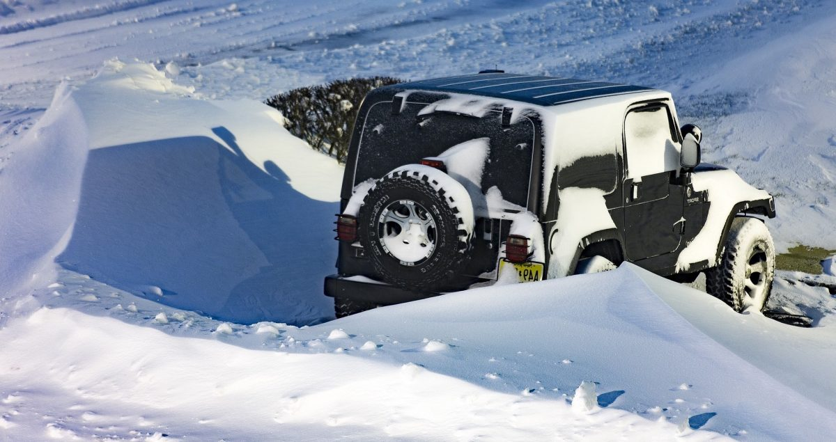 Image of a Jeep in a snowbank to illustrate story about car thief getting stuck in the snow.