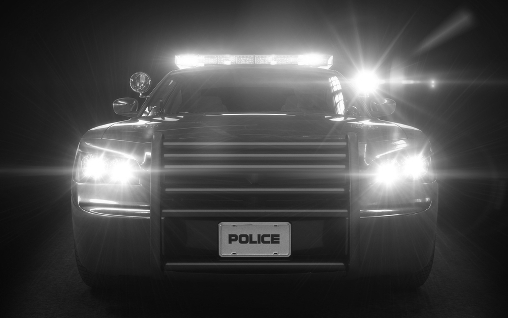 Image of police squad car at night for racial profiling post