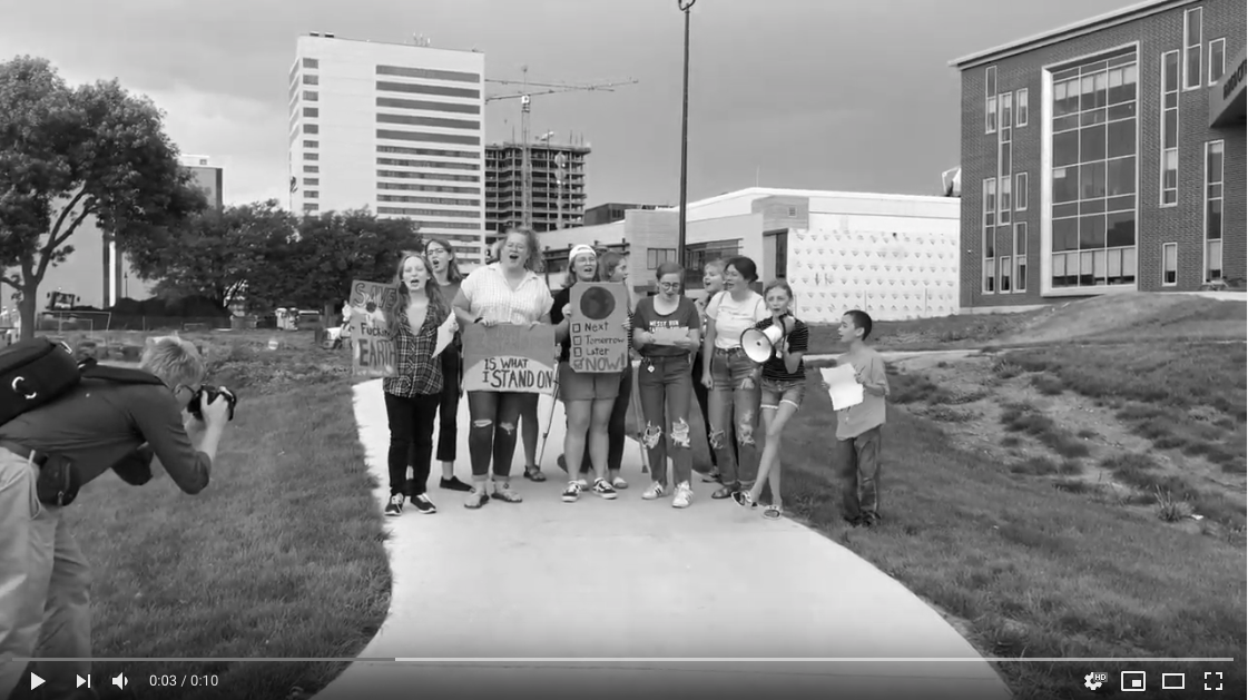 Still image from video of protesting kids at Fargo Climate Crisis Strike