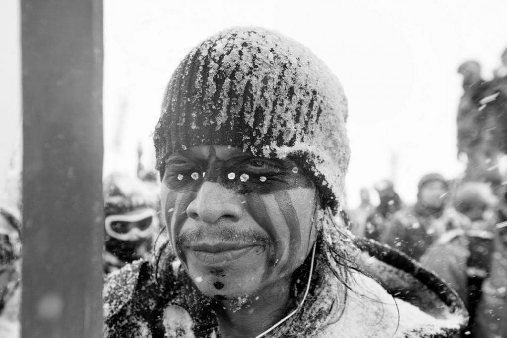 Image of a nonviolent water rights protester at Standing Rock