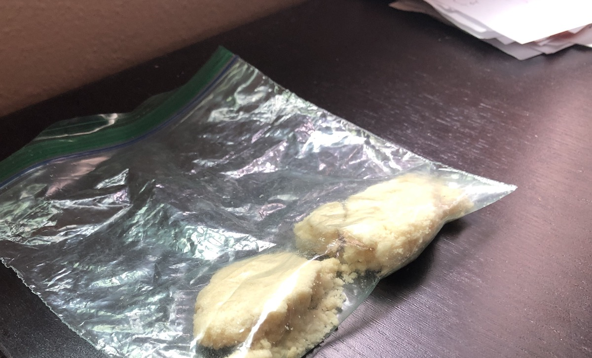 Photo of a broken sugar cookie in a Ziploc bag
