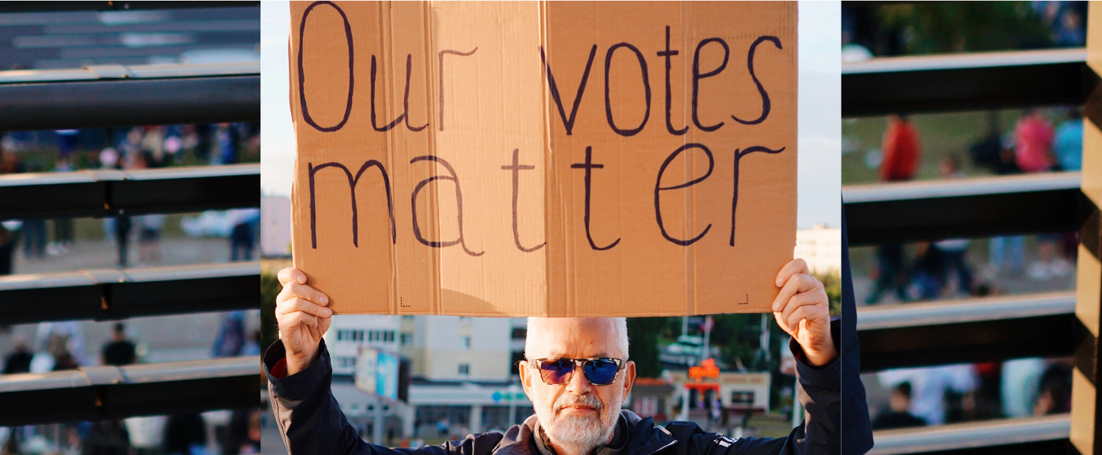 "Photo of progressive holding sign: ""Our votes matter"""