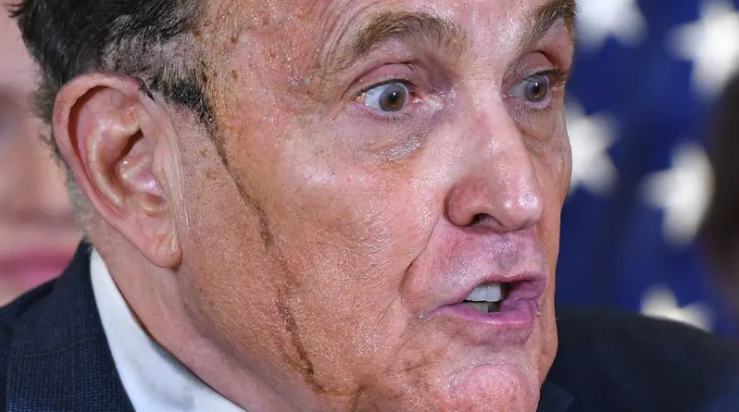 Rudy Giuliani sweats hair dye during a press conference