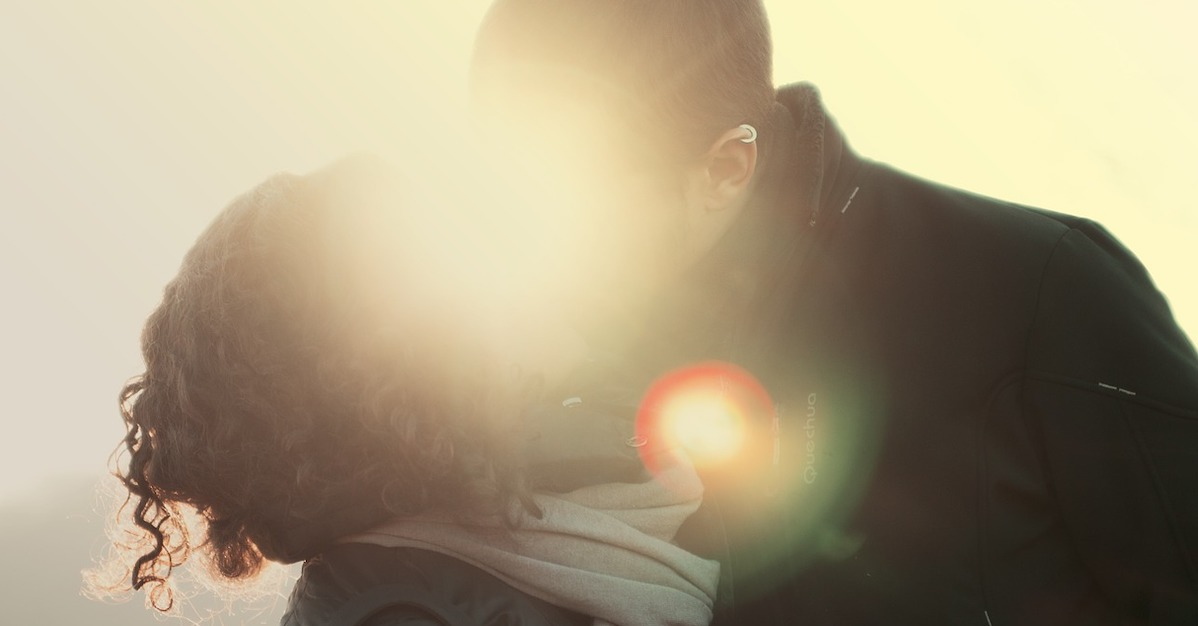 Image of woman kissing man