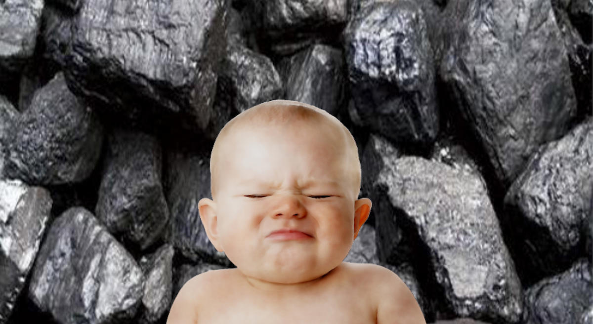 Photo of stubborn baby superimposed over lignite coal