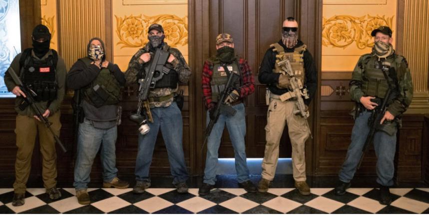 Image of armed men threatening democracy in Michigan