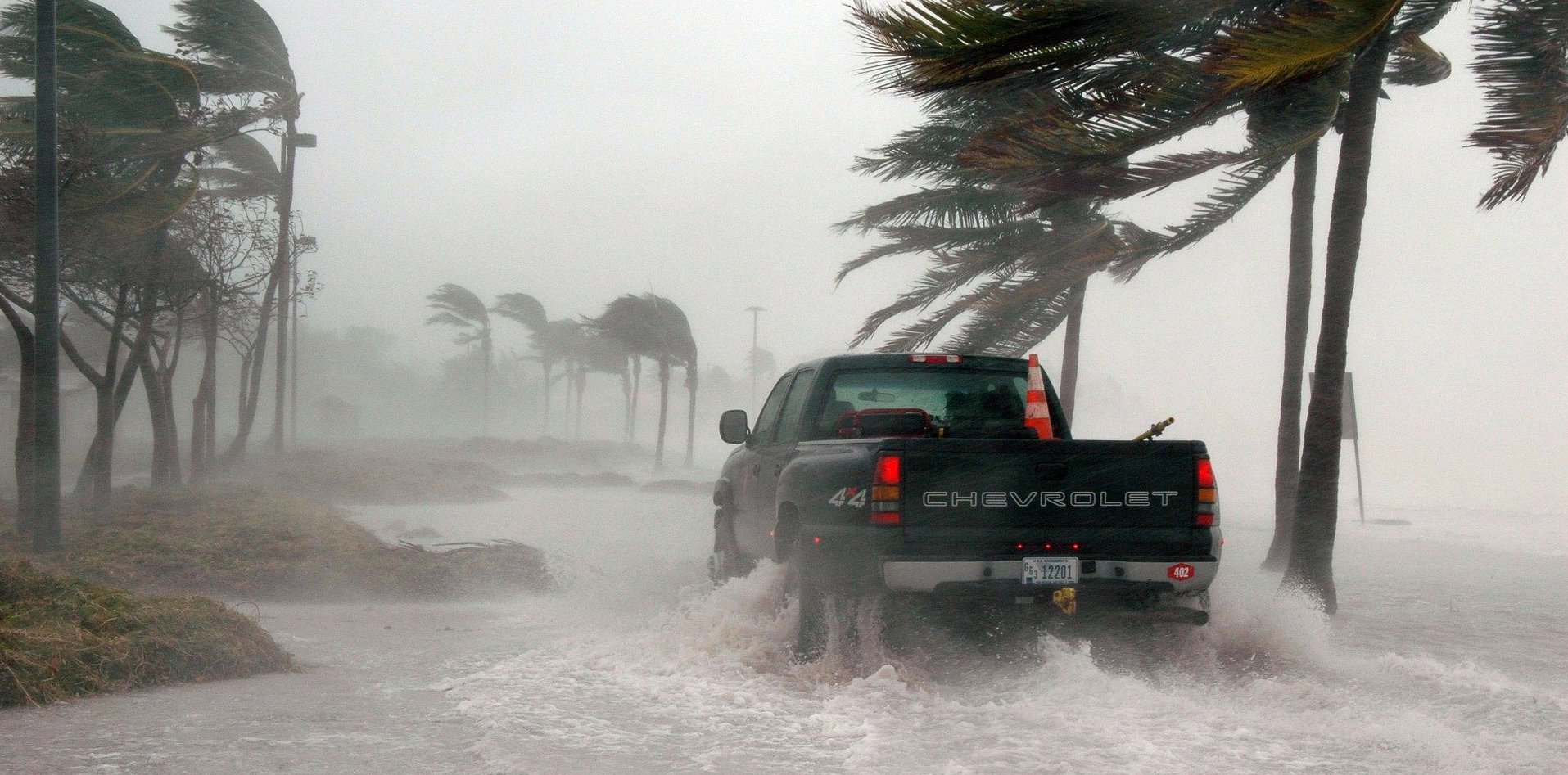 Photo of pickup truck during hurricane for climate crisis post