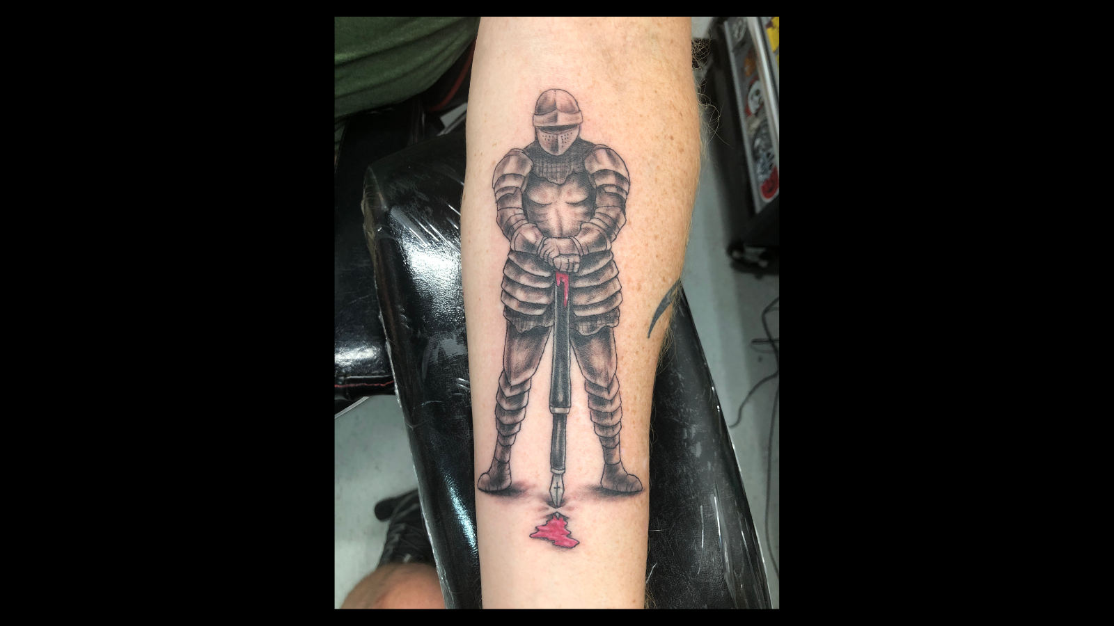 Photo of MCFIV's latest tattoo illustrating the pen is mightier than the sword