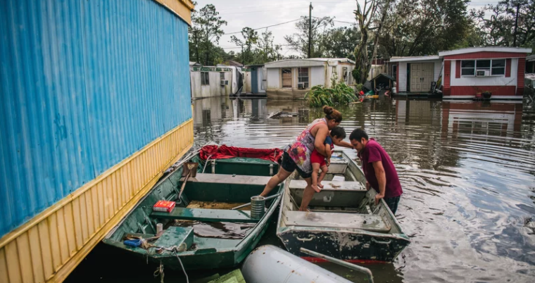Image of family getting into boat after Hurricane Ida